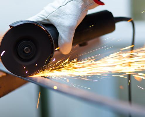 Worker using a grinder
